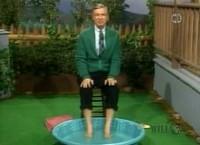 Mr. Rogers alone with his feet in a kiddie pool